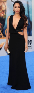 Actress Candice Patton showing naked cleavage in an evening gown