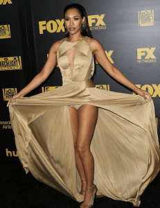 Sexy Candice Patton lifting her gown