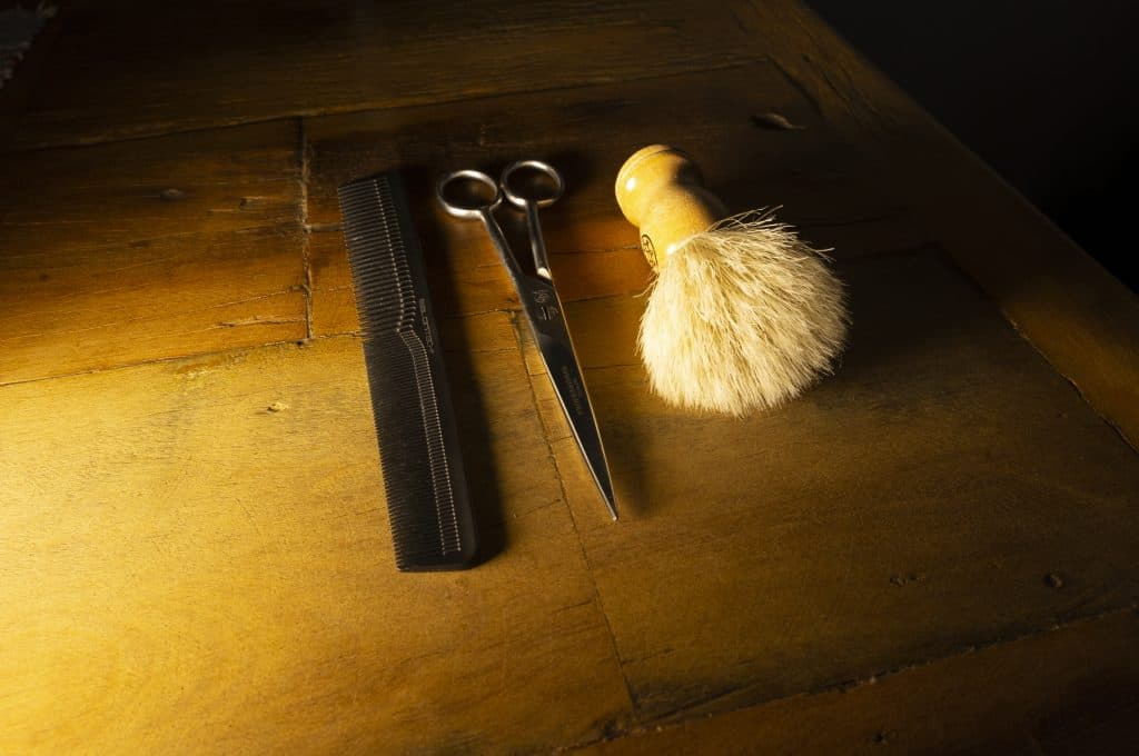 scissors and comb and shaving brush